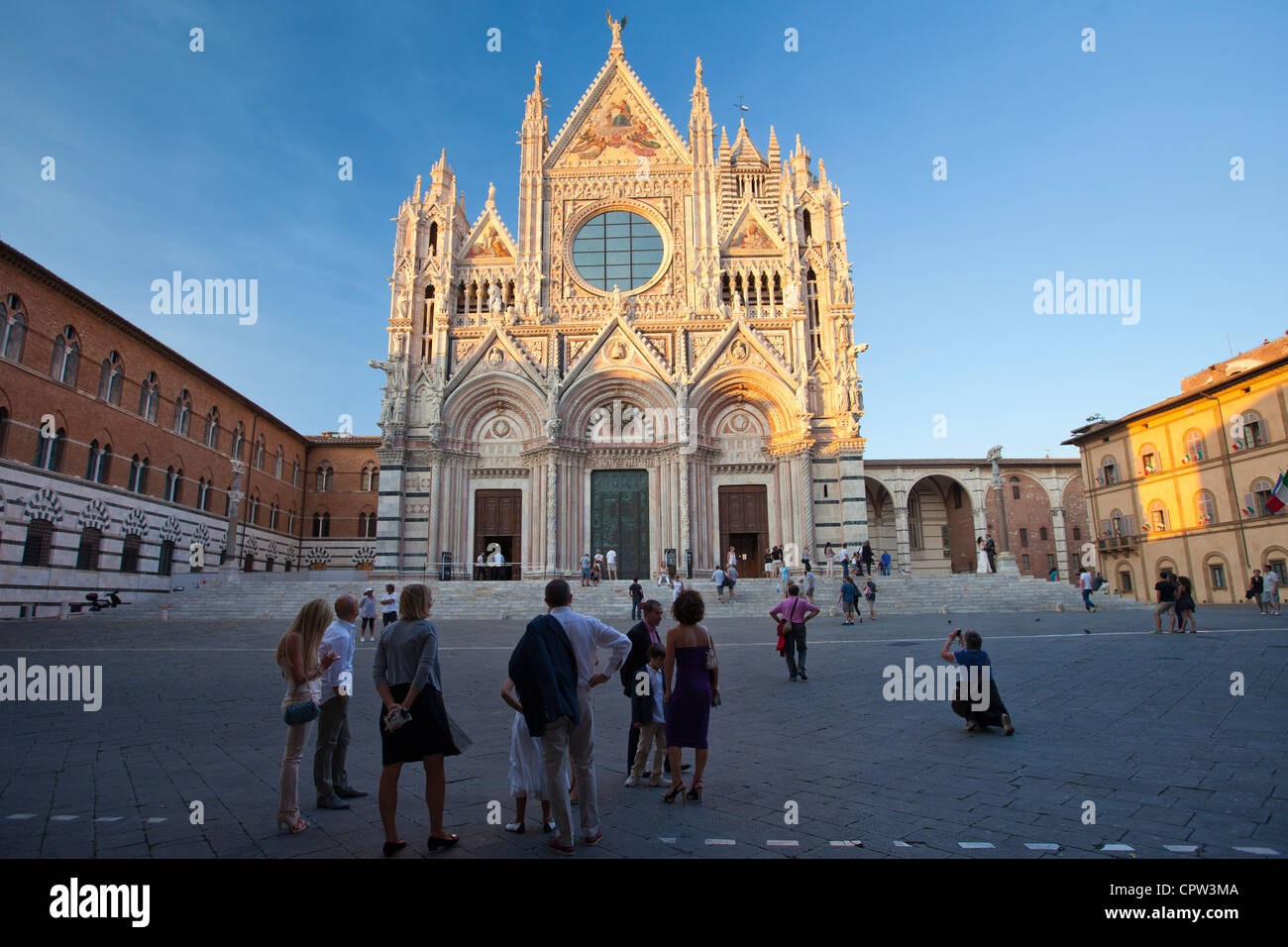 Tourists visit Il Duomo di Siena, the Cathedral of Siena, Italy - Stock Image
