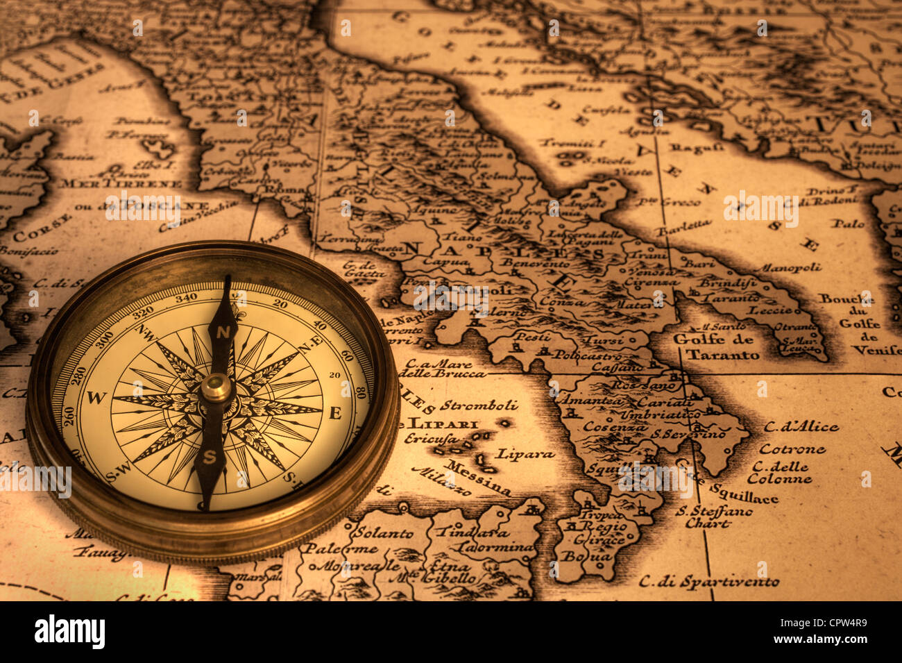 compass and old map of italy map is from 1680 and is out of stock