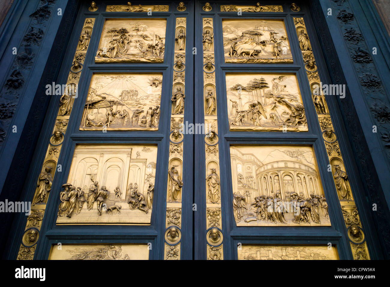 Religious scenes in gold on bronze on Baptistry doors Il Duomo di Firenze Cathedral of Florence in Piazza di San - Stock Image
