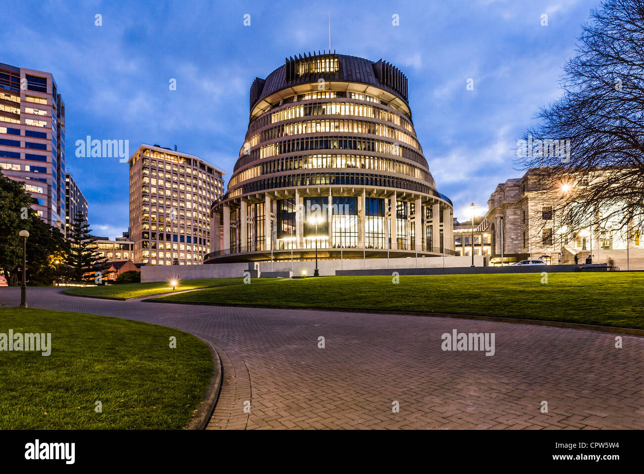 The Beehive, New Zealand's Parliament building, at twilight. - Stock Image