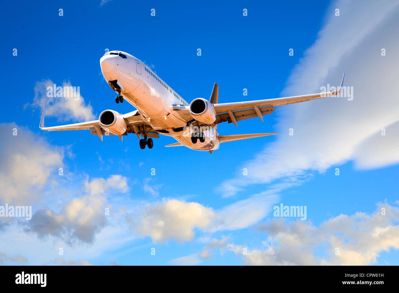 Boeing 737 landing from beatiful summer evening sky. - Stock Image