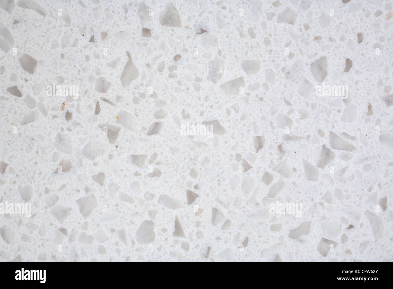 Closeup of a piece of cultured or composite granite, made from stone chips in a synthetic resin. - Stock Image