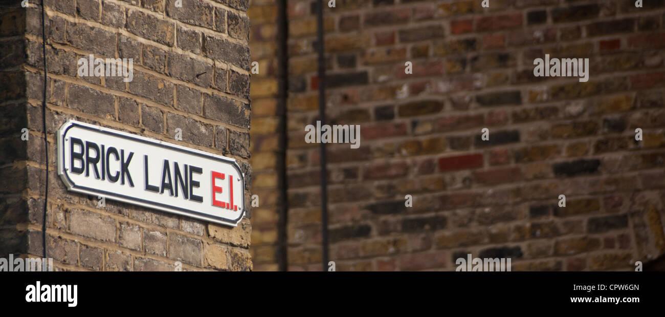 Brick Lane E1 Street Sign On Street Corner Brick Wall Background