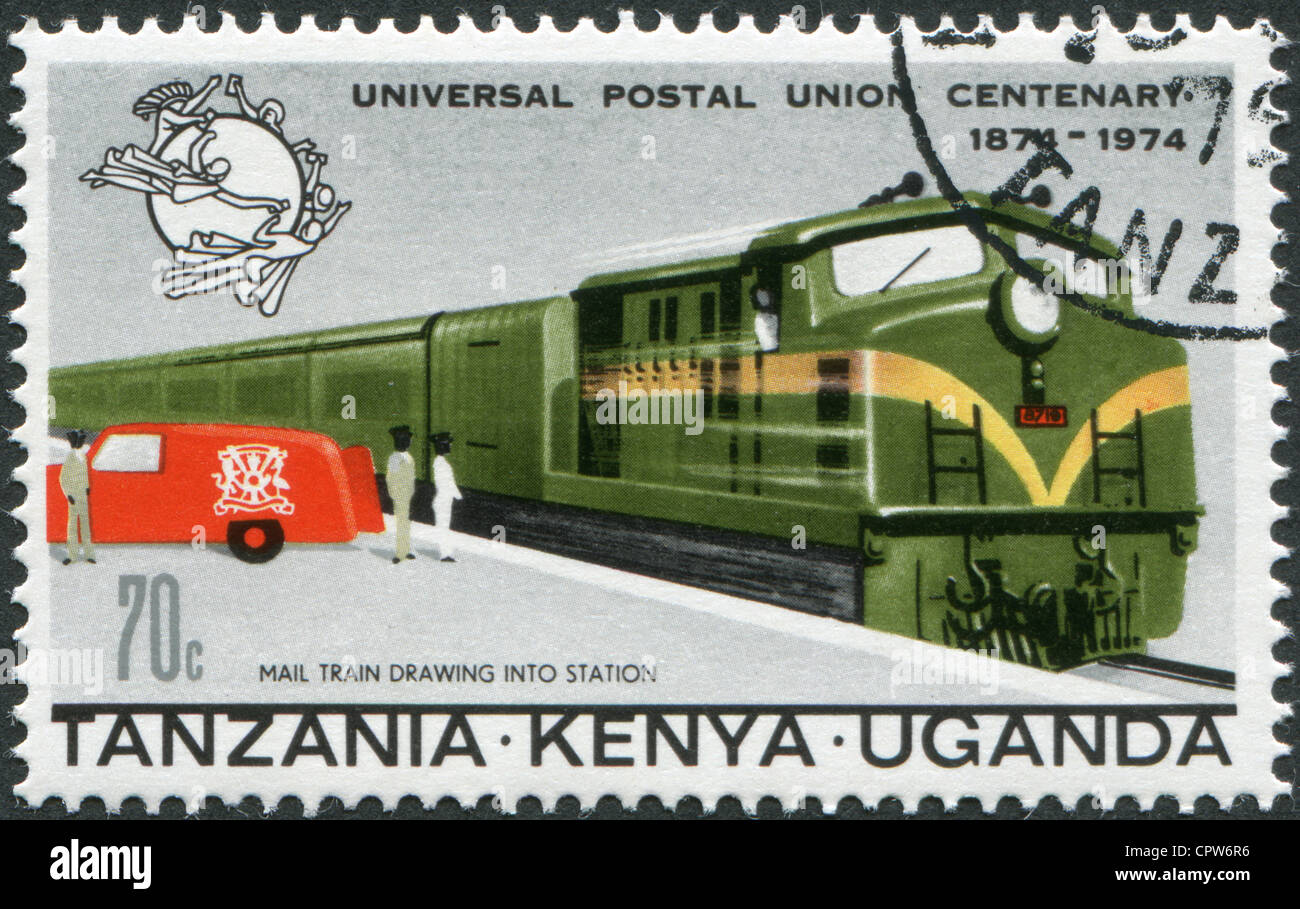 A stamp printed in East African Community, is dedicated to the 100th anniversary of the UPU, shows a mail train - Stock Image