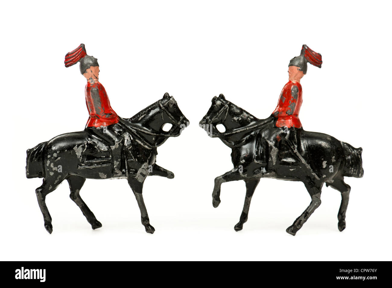 Pair of vintage lead toy soldiers on horseback - Stock Image