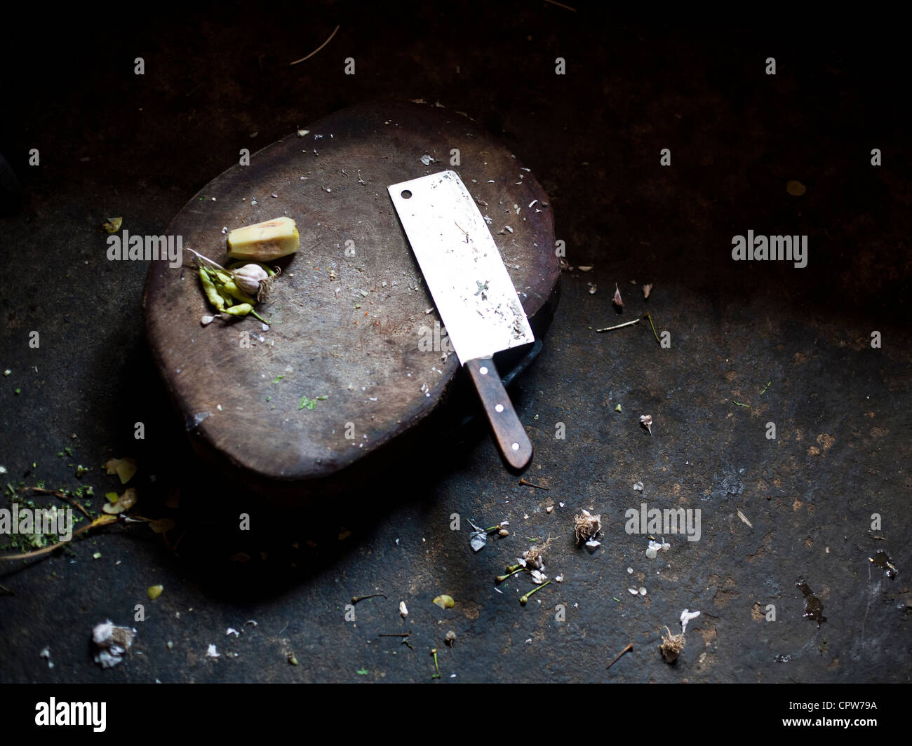 Meat chopper in a village in China - Stock Image