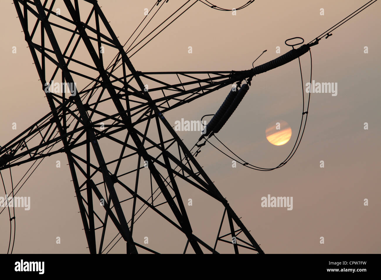 Electricity pylons at sunset in Manchester, UK - Stock Image
