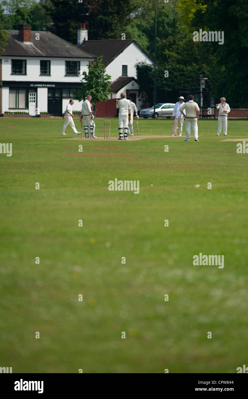Vllage cricket match at Ham Common in the London Borough of Richmond upon Thames, England, UK - Stock Image
