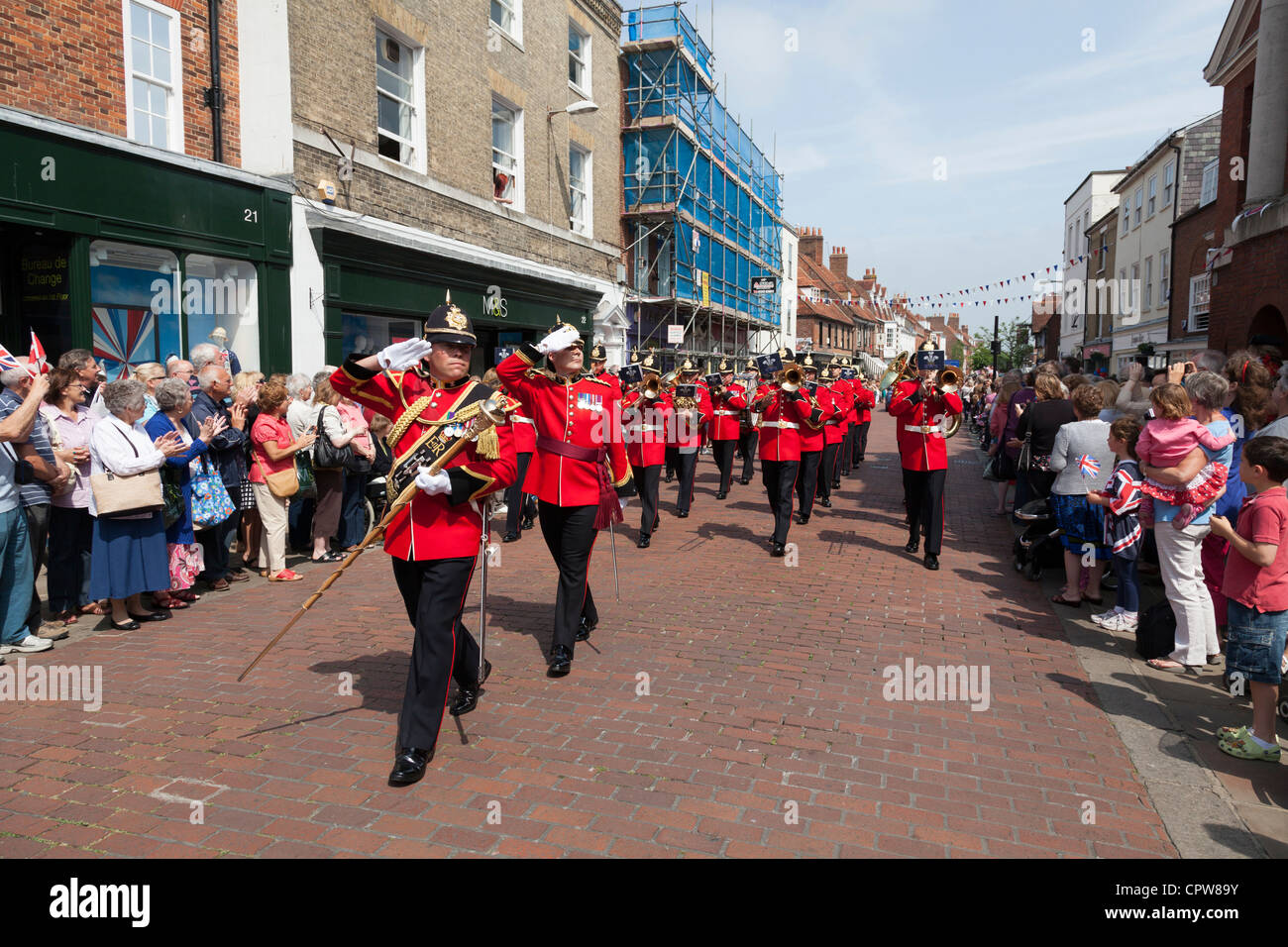 marching military banr in Chichester diamond jubilee celebration procession - Stock Image
