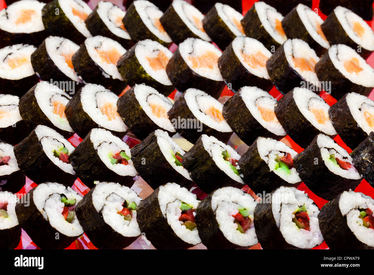 traditional japanese cuisine- sushi rolls served at a party - Stock Image