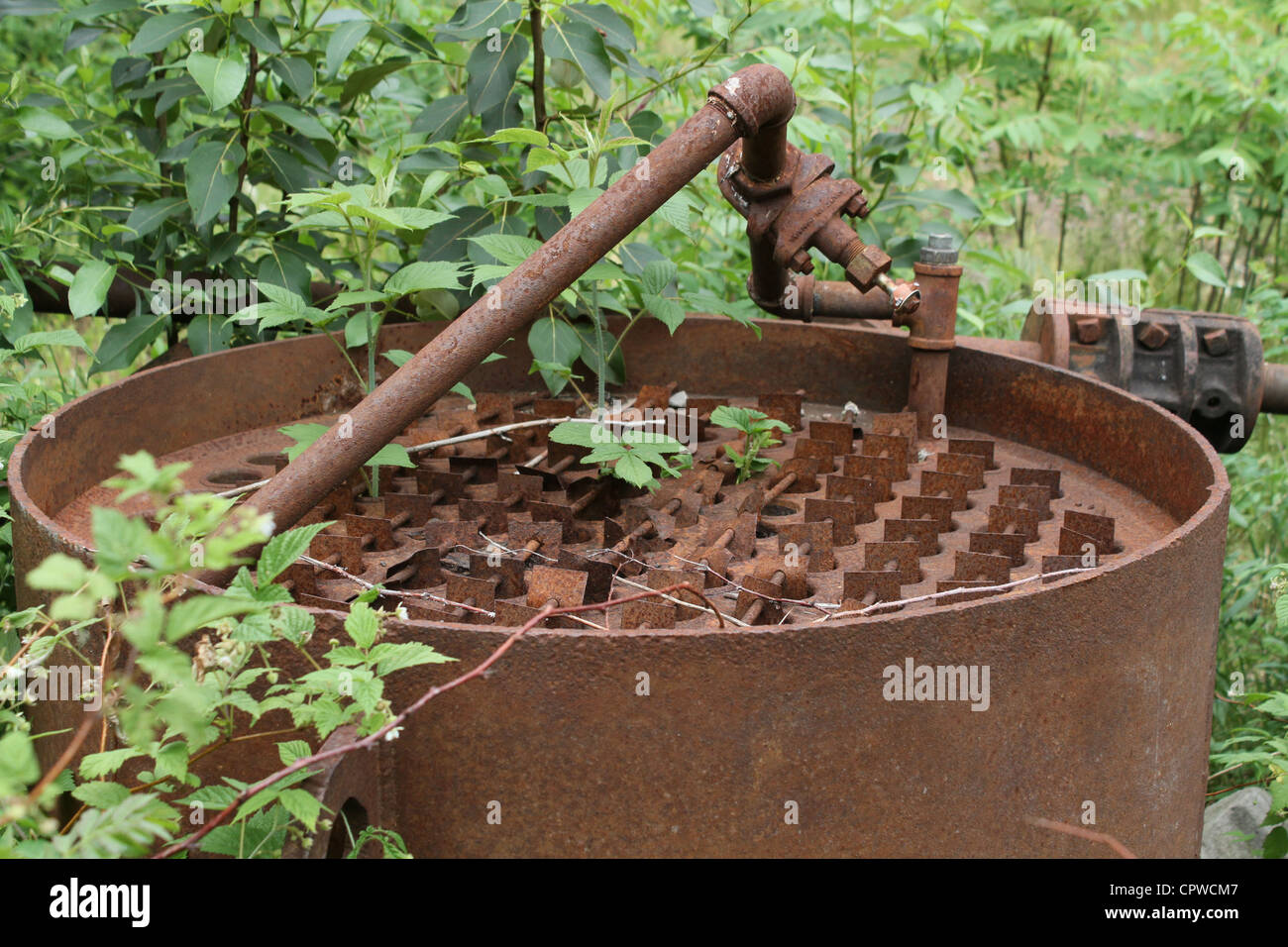 rusty factory metal forest abandoned hazard - Stock Image