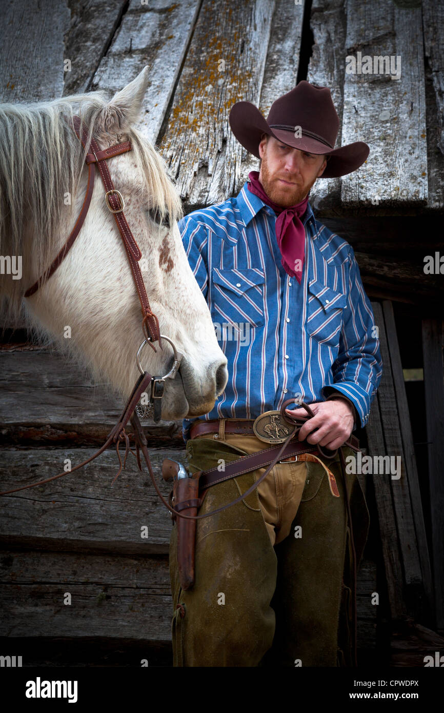 A cowboy and his horse on a rnach in northeastern Wyoming - Stock Image