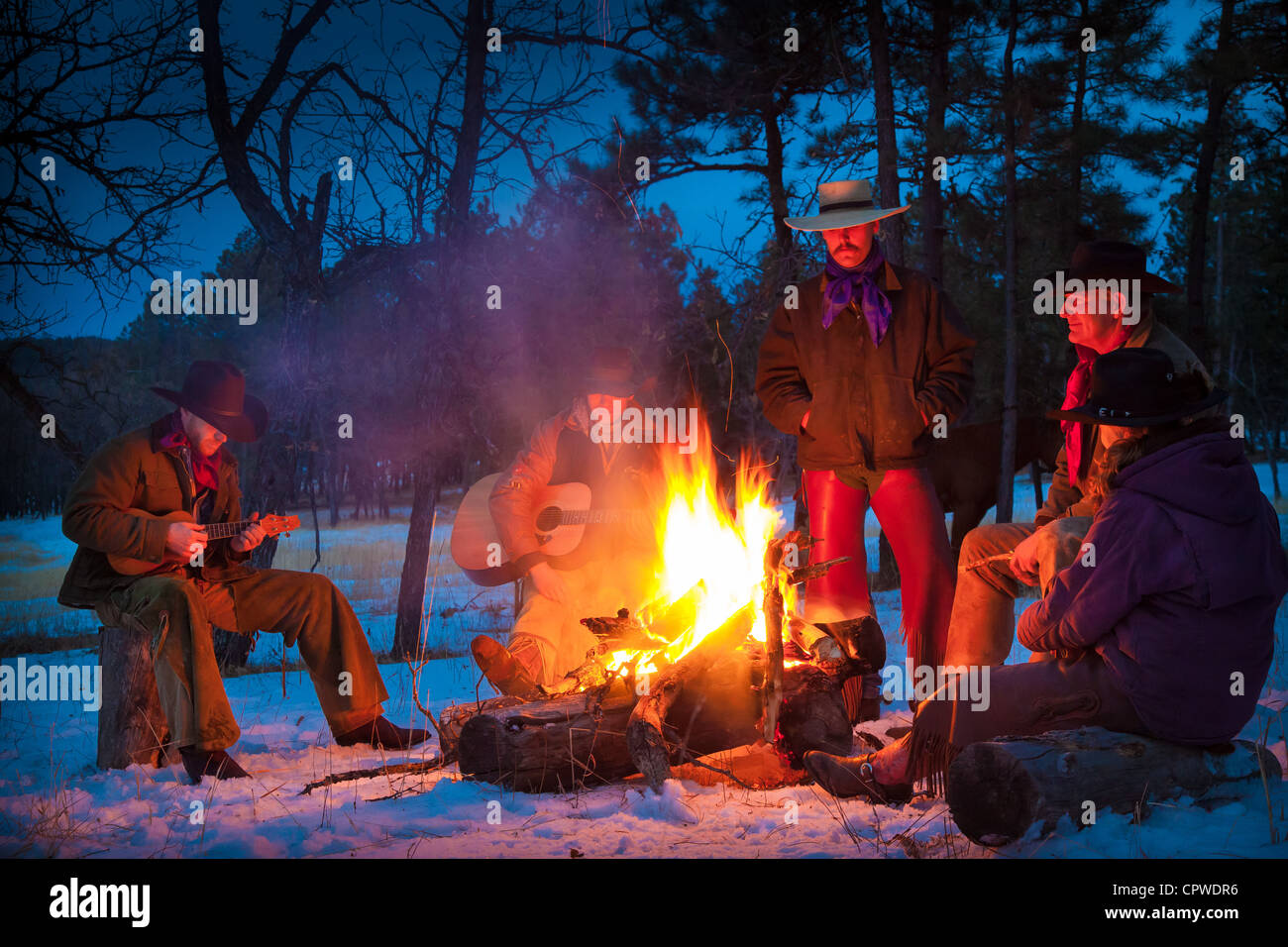 Cowboys and cowgirl around a campfire on a ranch in northeastern Wyoming - Stock Image
