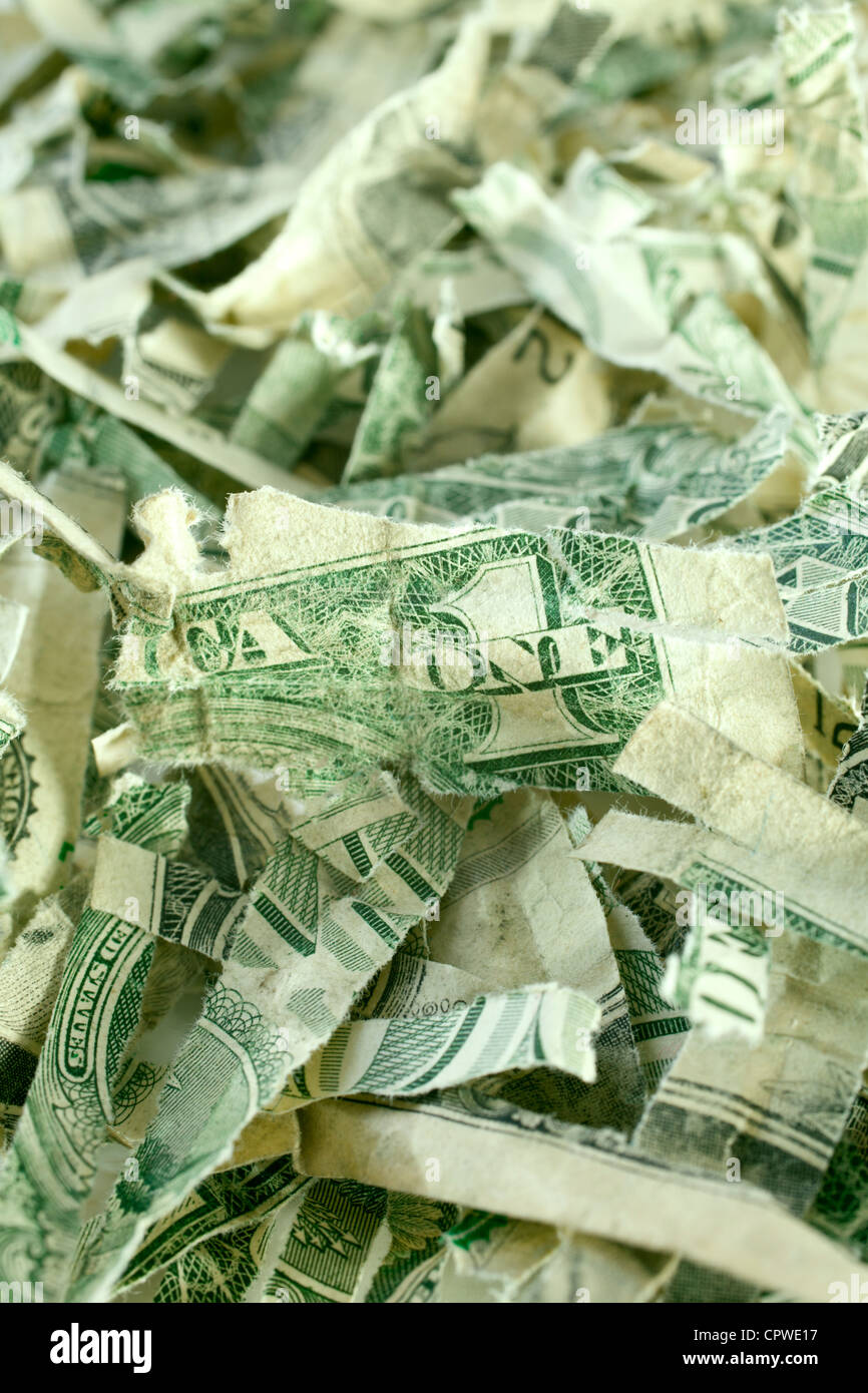 A pile of shredded US dollar bills. Concepts of throwing money away, low value currency. - Stock Image