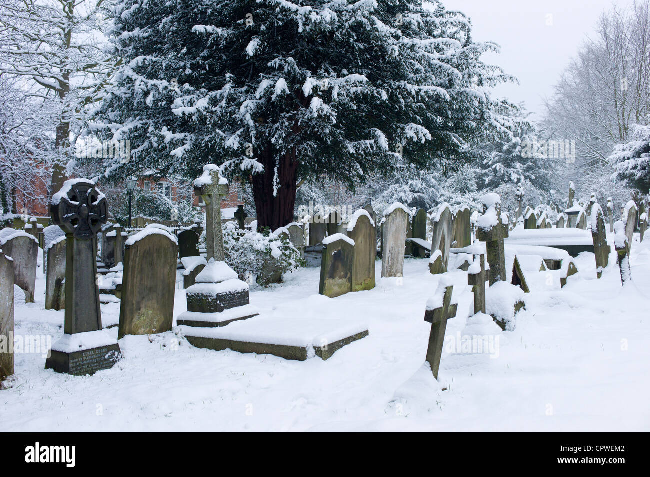 Snow-covered gravestones in Hampstead Parish Graveyard in Church Row and Holly Place in Hampstead, North London, - Stock Image