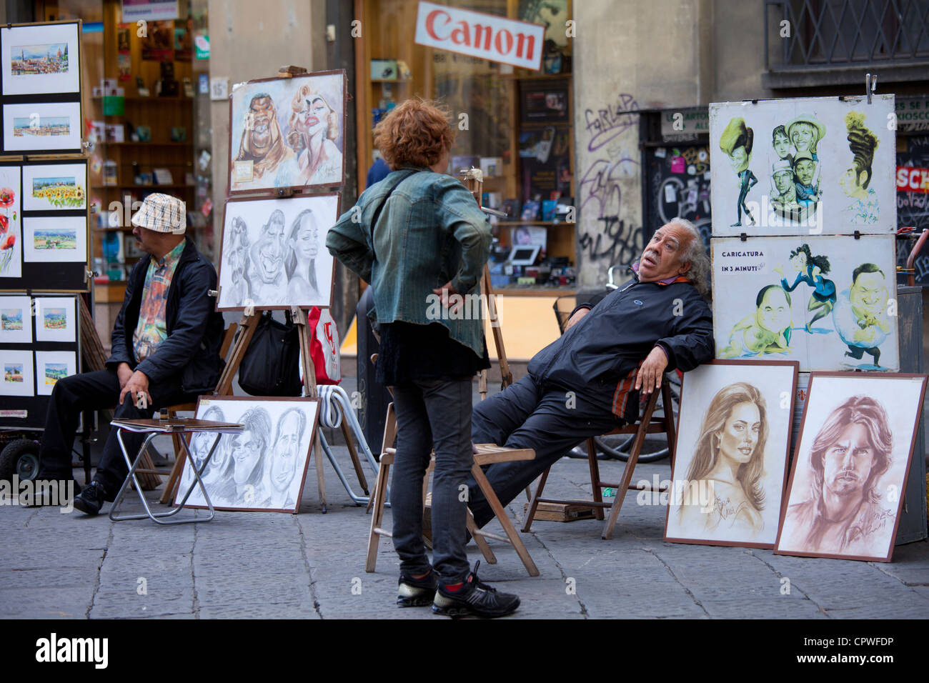Pavement artists and souvenir stalls in Piazza di San Giovanni, Italy - Stock Image