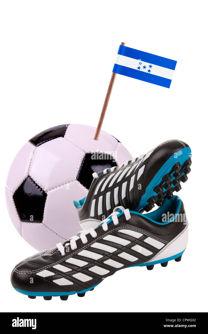 Pair of cleats or football boots with a small flag of Honduras Stock Photo