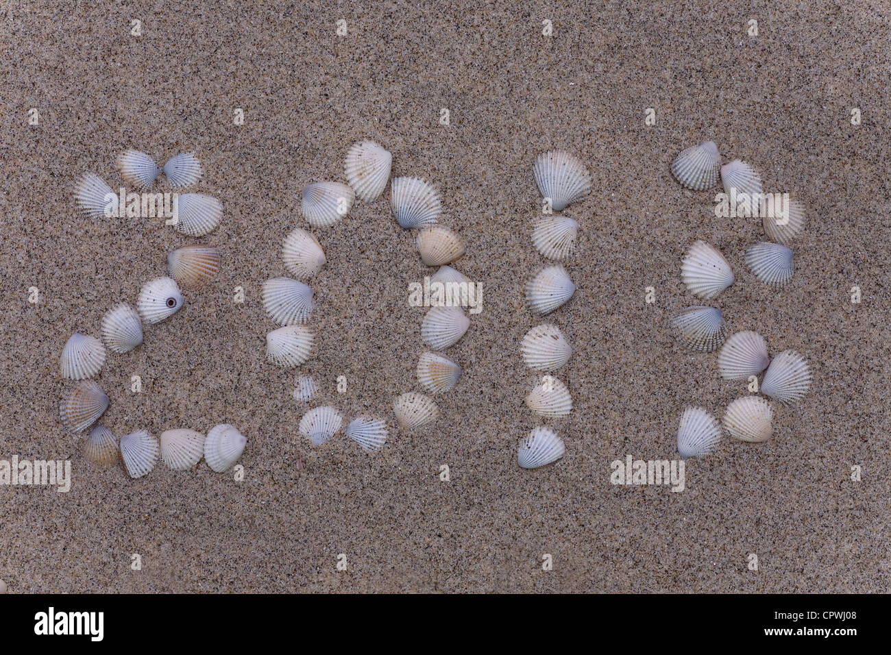 new 2013 year numbers drawings from shell in the sand on the beach - Stock Image