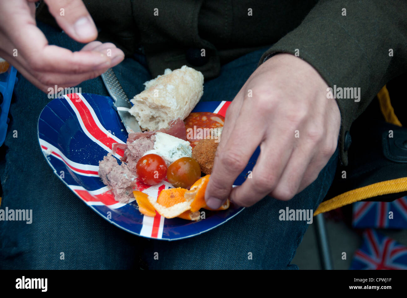 Flotilla on the Thames - man holding Union Jack paper plate with picnic snack & Flotilla on the Thames - man holding Union Jack paper plate with ...