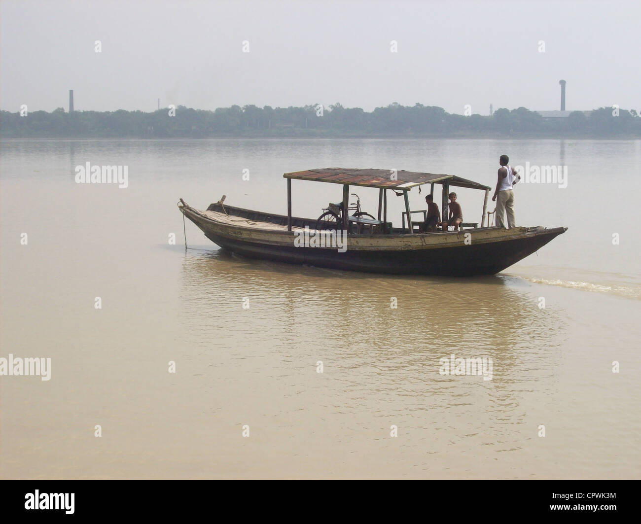 Boatmen plying on the Ganges river. - Stock Image