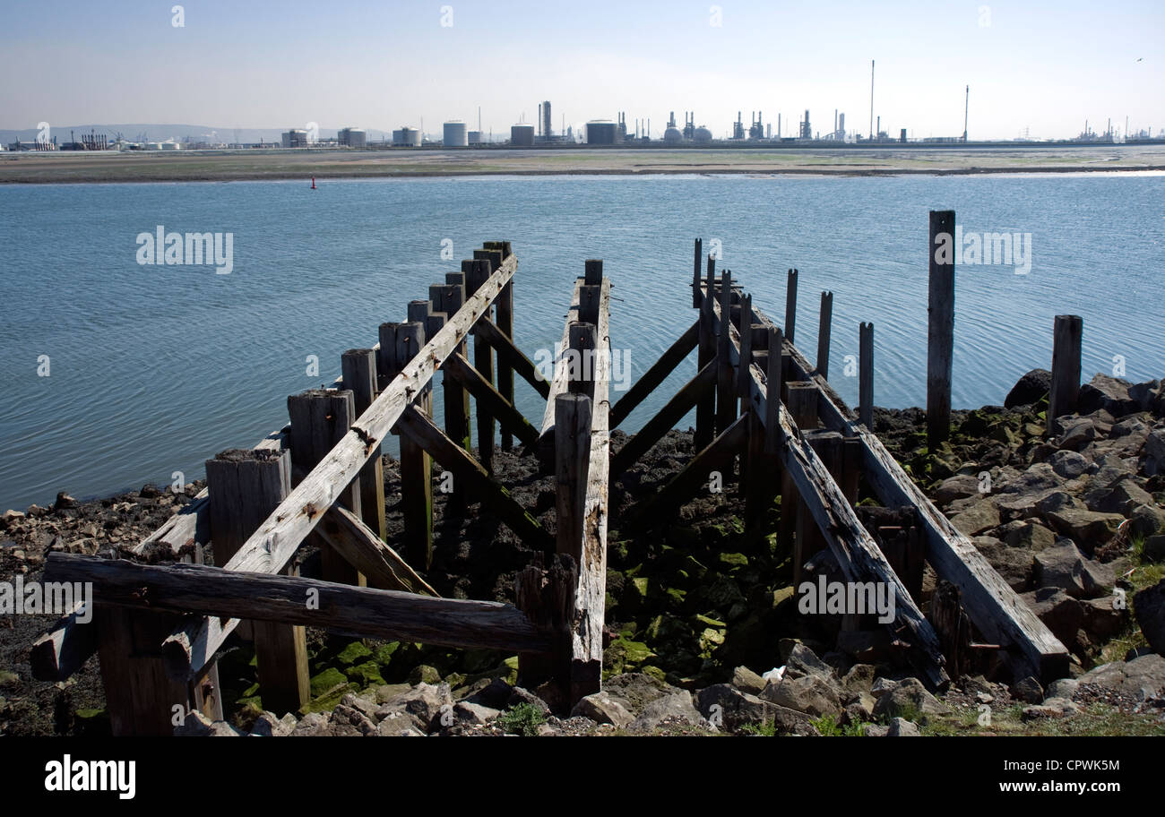 Old wooden wharves across the Tees from Seal Sands - Stock Image