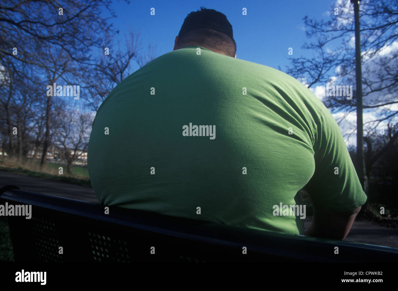 colossus of obese man from the rear - Stock Image