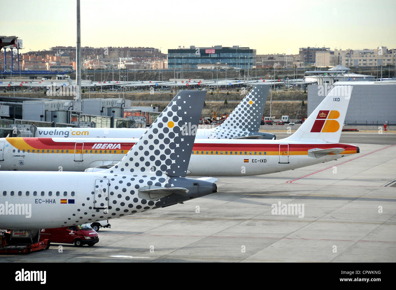 Iberia and Vueling.com planes Barajas international airport Madrid Spain - Stock Image