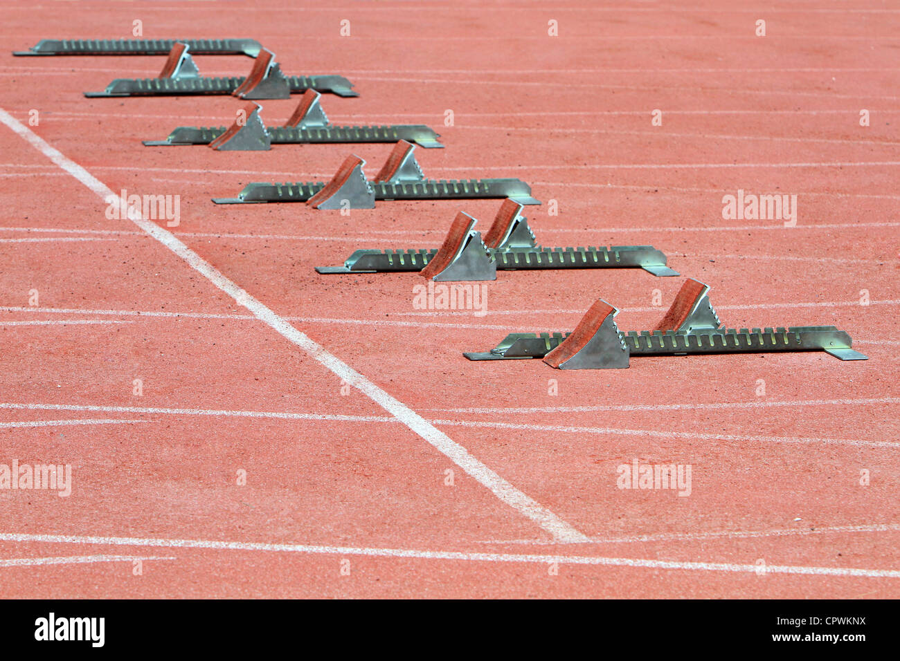 Athletics Starting Blocks on a red running track in the stadium. - Stock Image