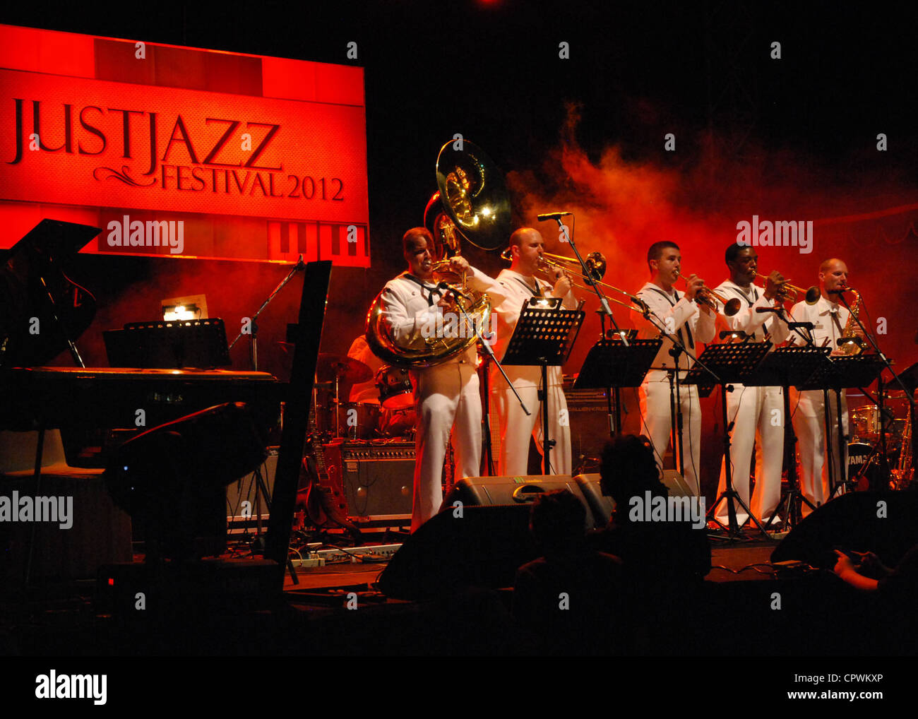 The U.S. Navy 7th Fleet Band, Orient Express, performs at a jazz festival during Cooperation Afloat Readiness and Stock Photo
