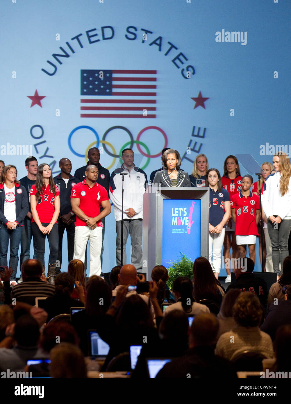 First Lady of the United Sates of America Michelle Obama speaks to media with USA Olympic athletes on stage - Stock Image