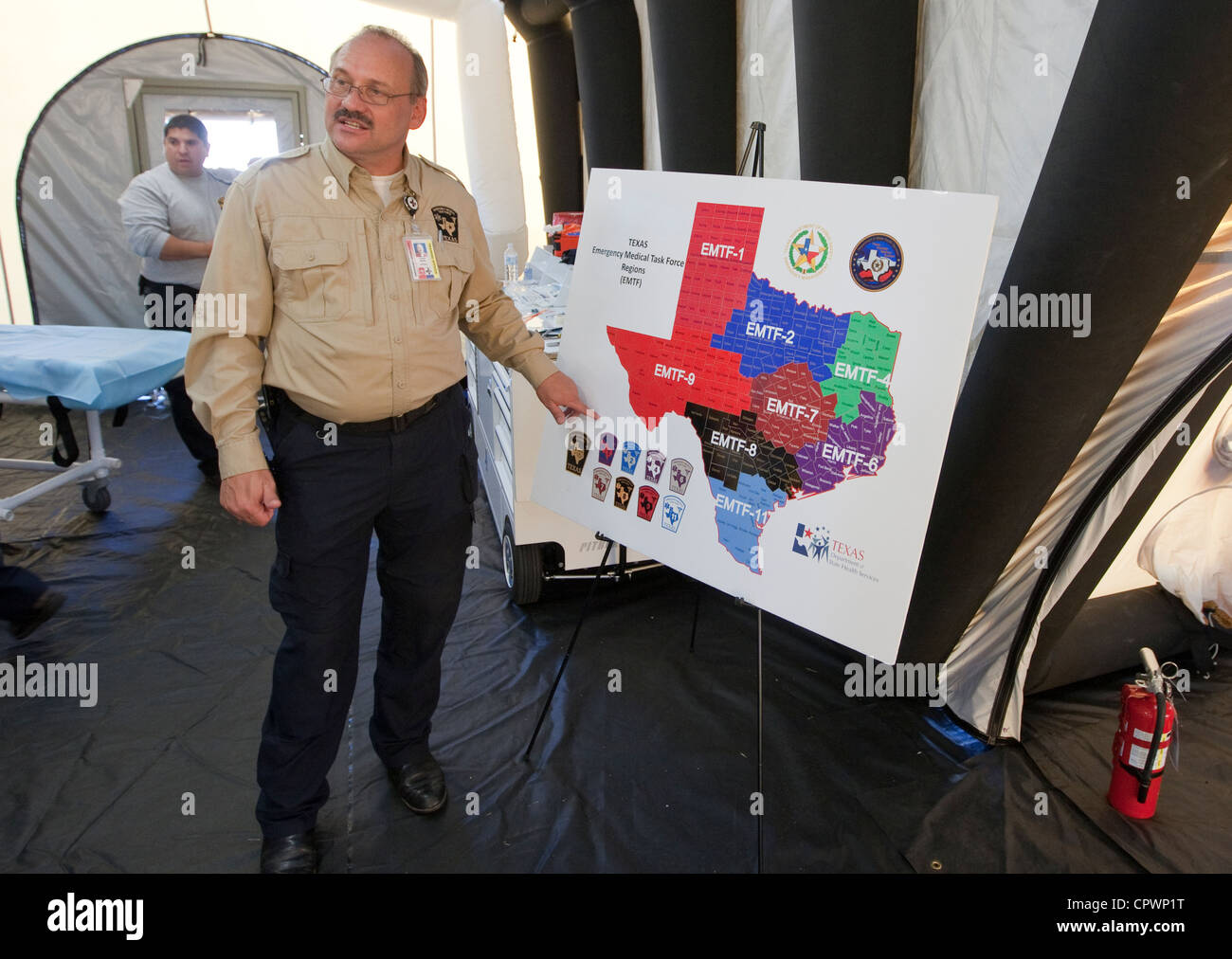 male training officer , displays map of Texas showing the different Emergency Medical Task Force Regions - Stock Image