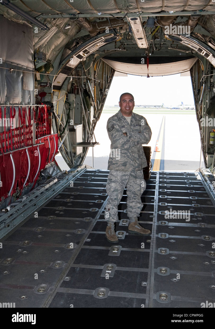 Sargent Robert Lopez , member of the Texas Air National Guard in empty C130 cargo aircraft during training exercise - Stock Image