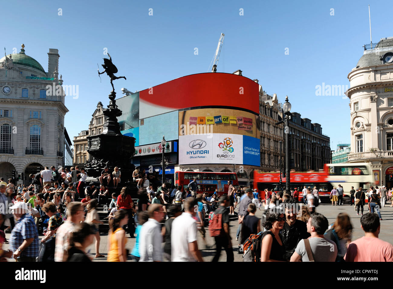 Crowds of tourists at Piccadilly Circus in central London - Stock Image