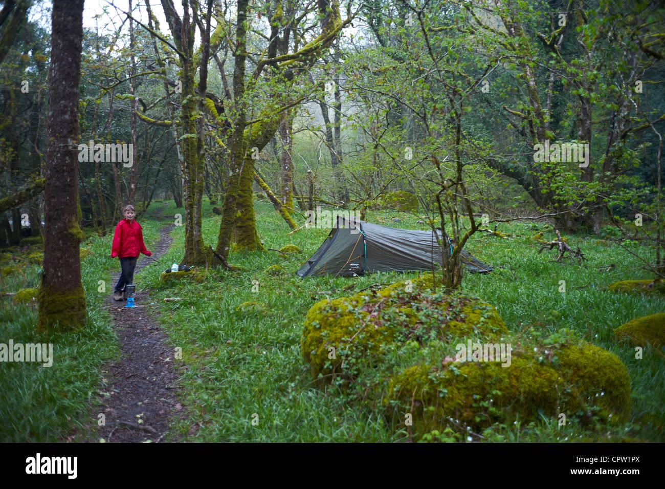 A child wild camping by the river dart new newbridge ...