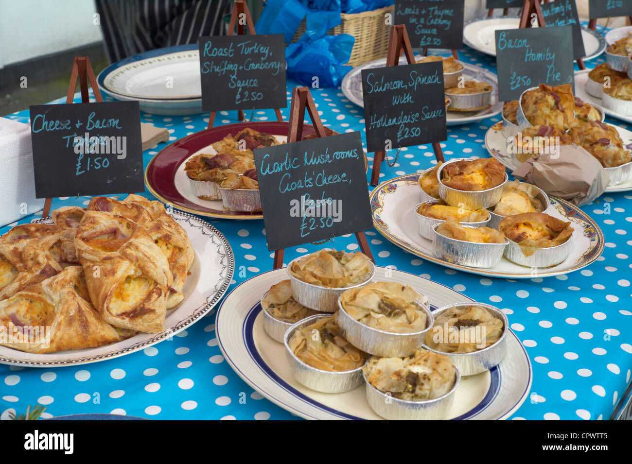 Savory pastries and pies on sale at Bovey Tracey Farmers Market Devon England - Stock Image