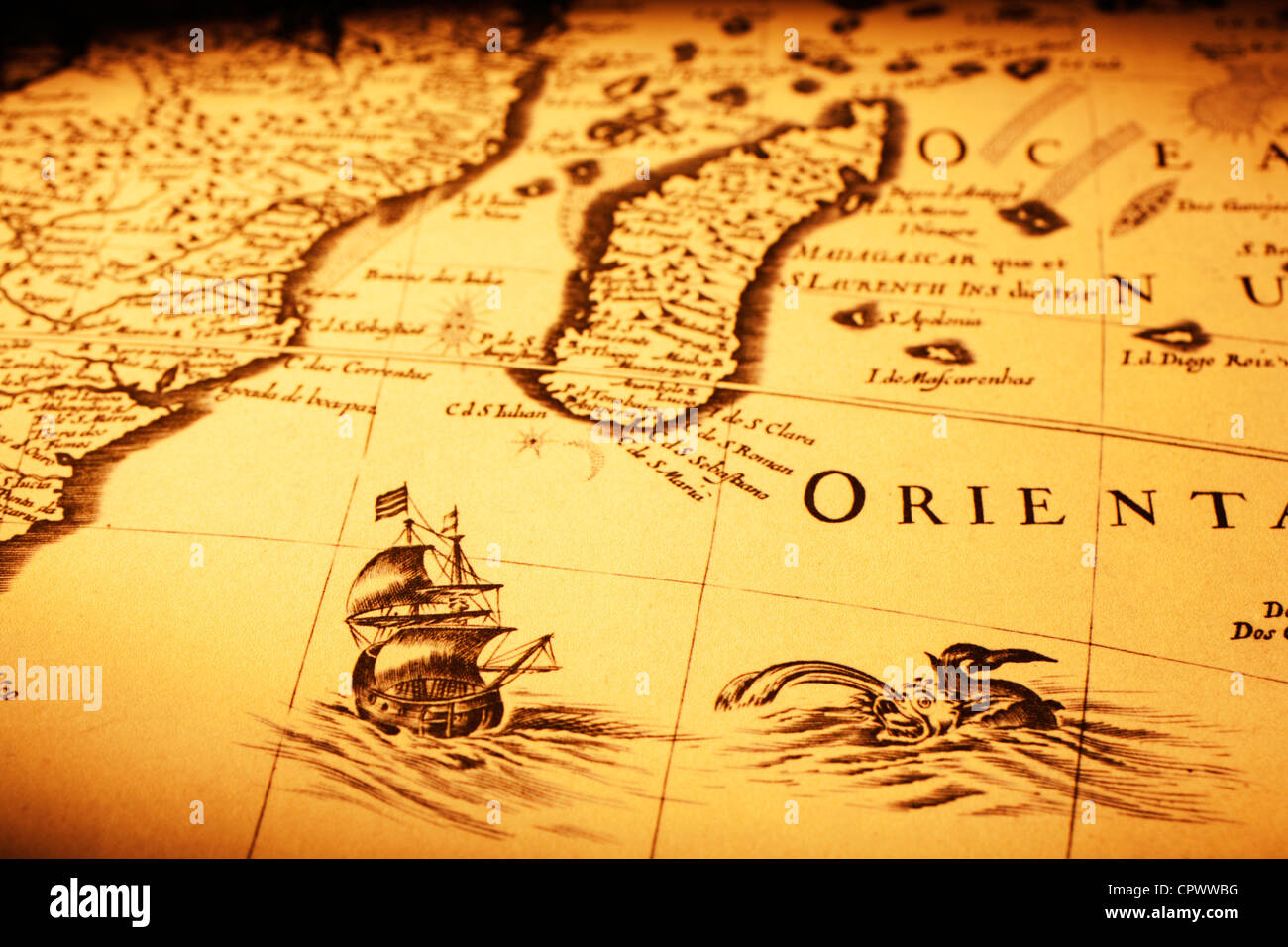 Detail from an old map showing a ship off Madagascar, a sea monster and the coast of Africa. - Stock Image