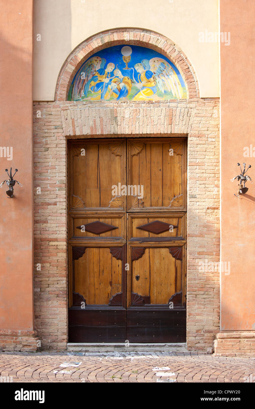 Traditional painted wall mural at church in Quartiere Ruga in Montalcino, Val D'Orcia,Tuscany, Italy - Stock Image
