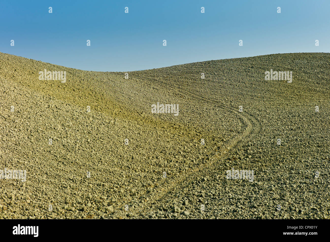 Tuscan parched landscape sun-baked soil in Val D'Orcia, Tuscany, Italy - Stock Image