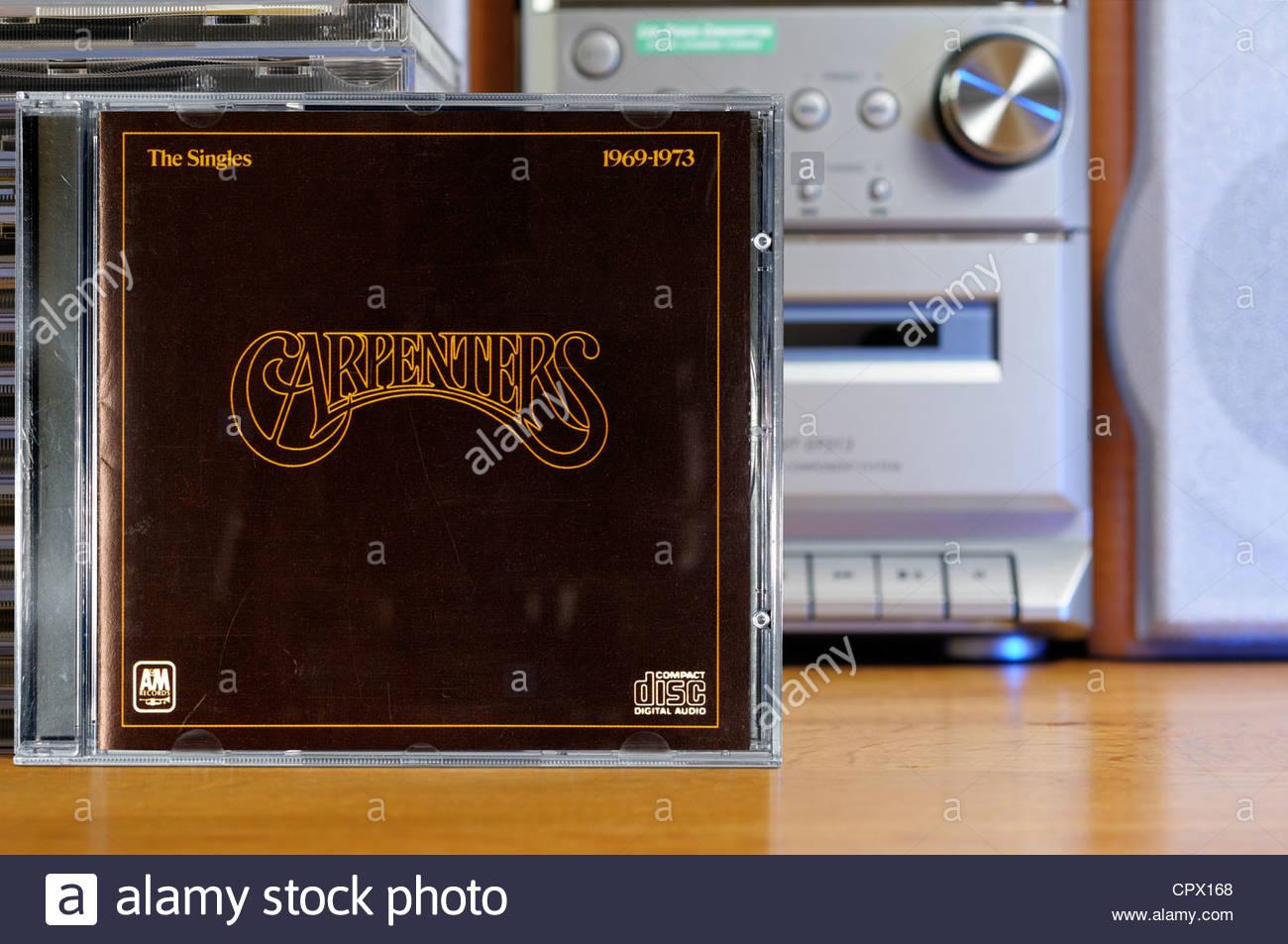 Carpenters album The Singles 1969-1973, piled music CD cases, England. Stock Photo