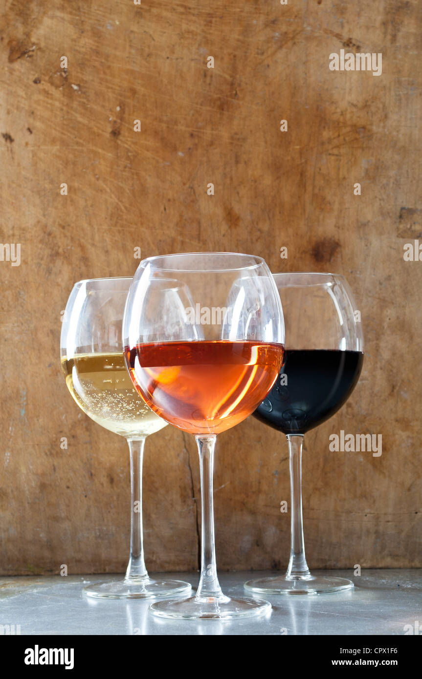 Rose, white and red wines in glasses - Stock Image