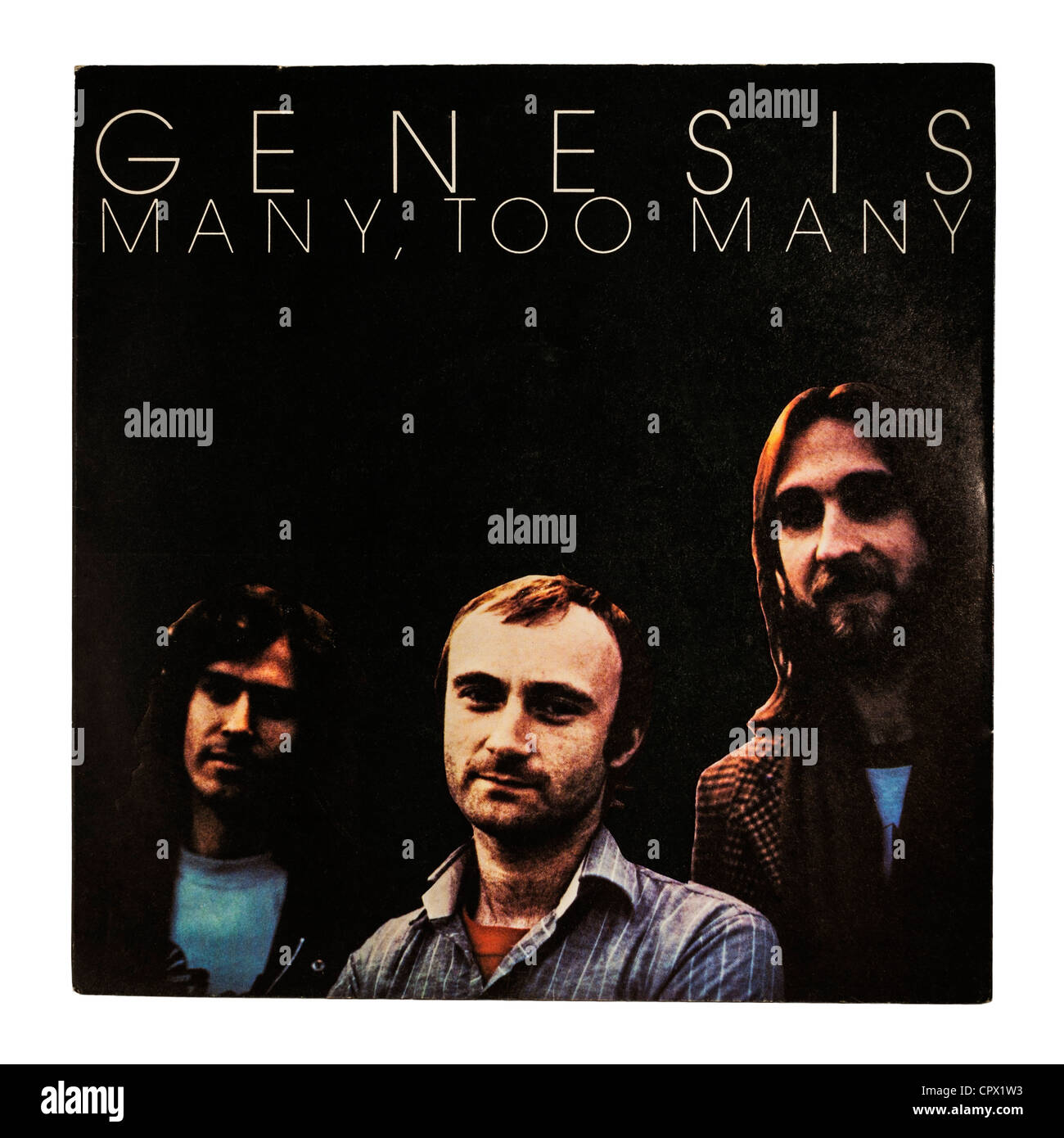 A vinyl single record by Genesis on a white background - Stock Image