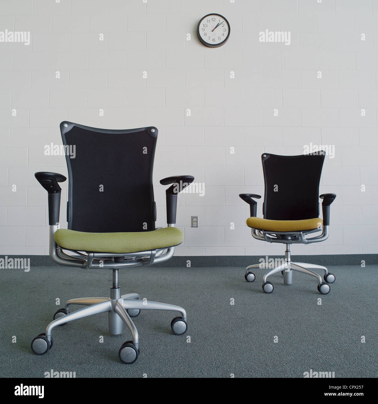 Empty office chairs in office - Stock Image