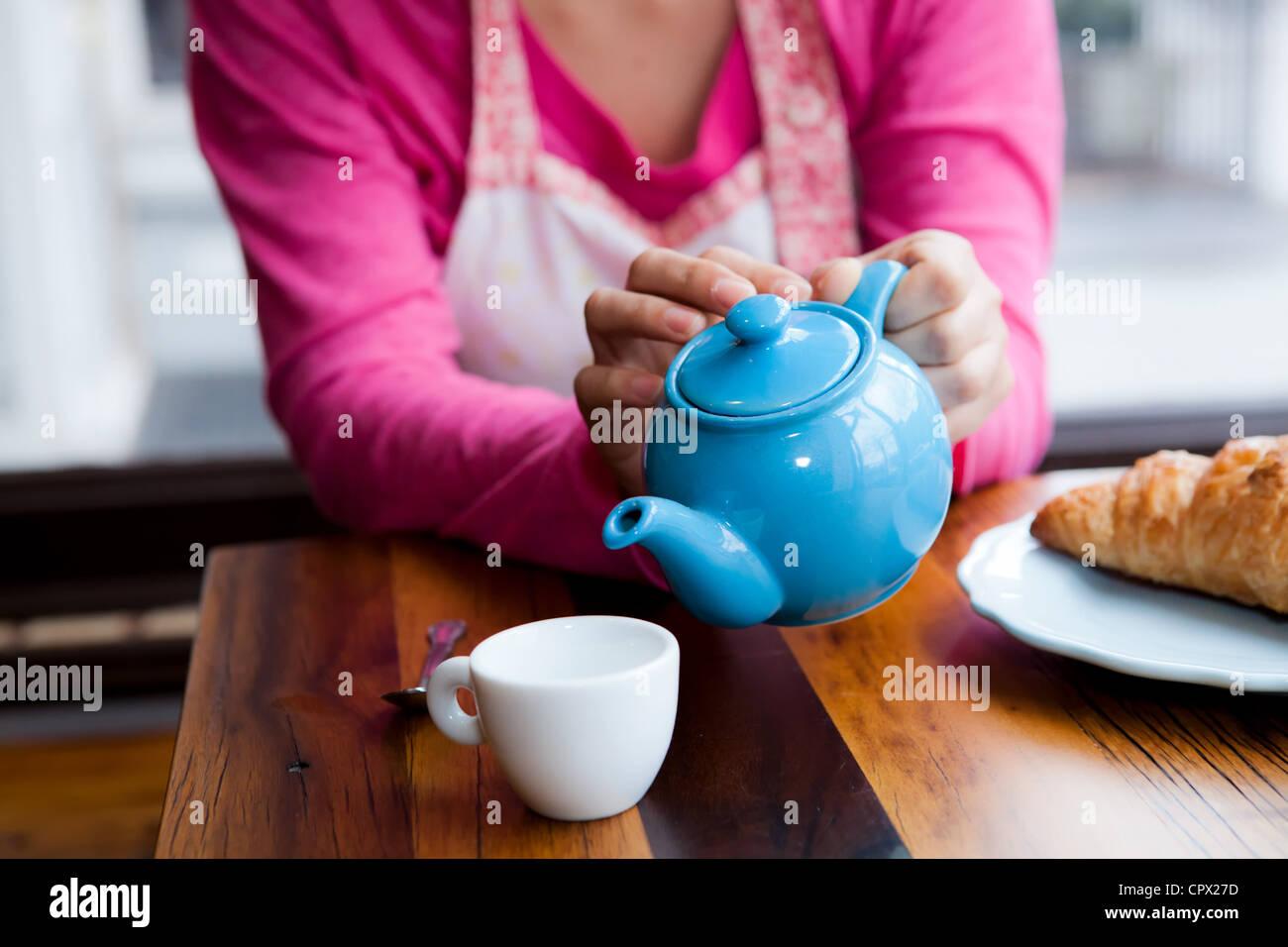 Pouring tea Stock Photo