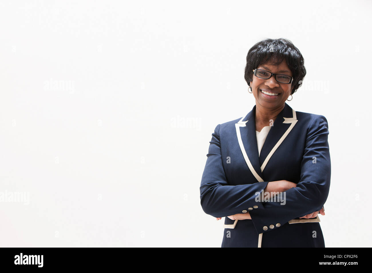 Portrait of mature African American businesswoman, studio shot - Stock Image