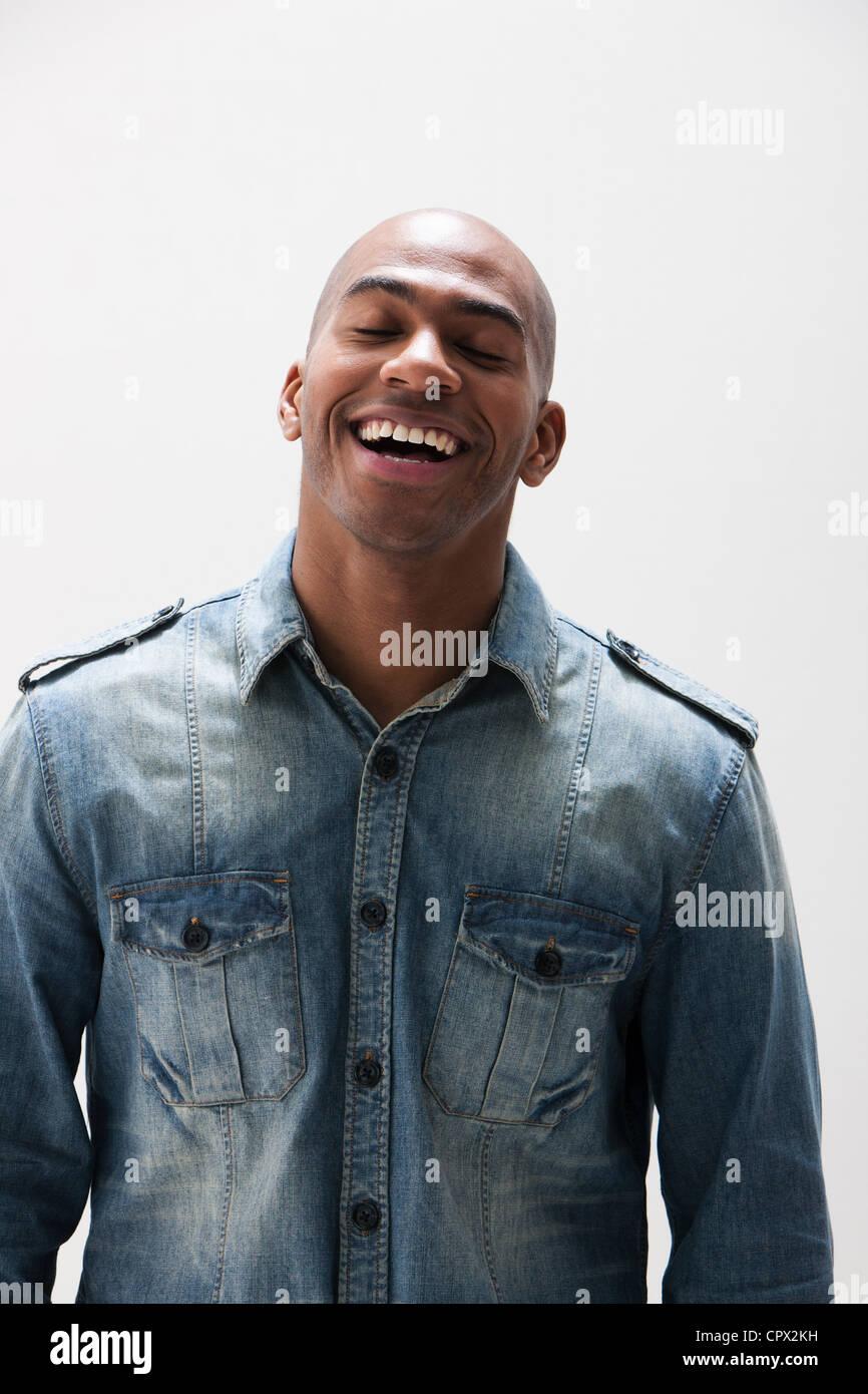 African American man smiling, studio shot - Stock Image