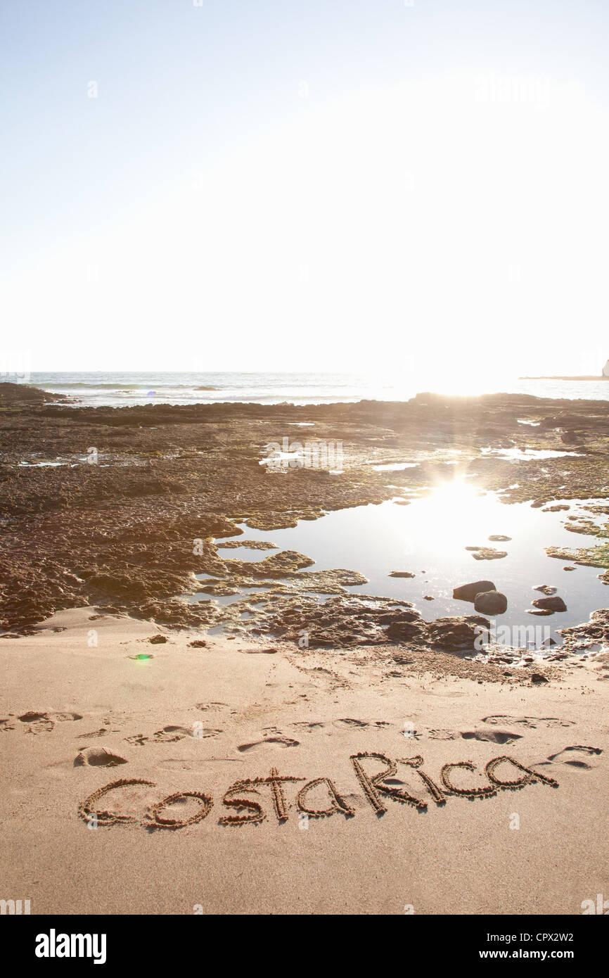 Costa Rica written in sand, Playa Grande, Santa Cruz, Costa Rica - Stock Image