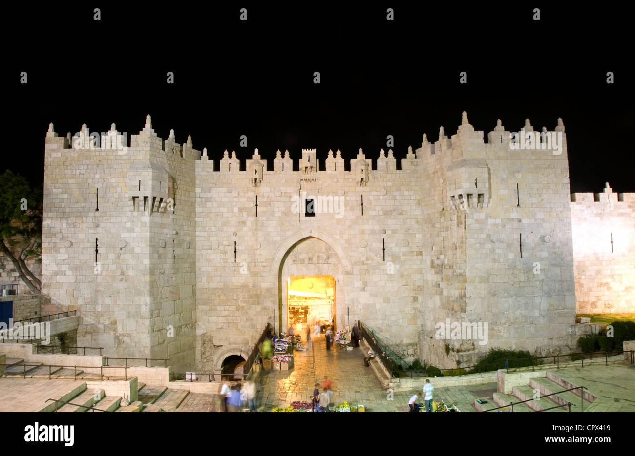 Damascus Gate entrance Old City Jerusalem Palestine Israel night light long exposure motion blur faces - Stock Image