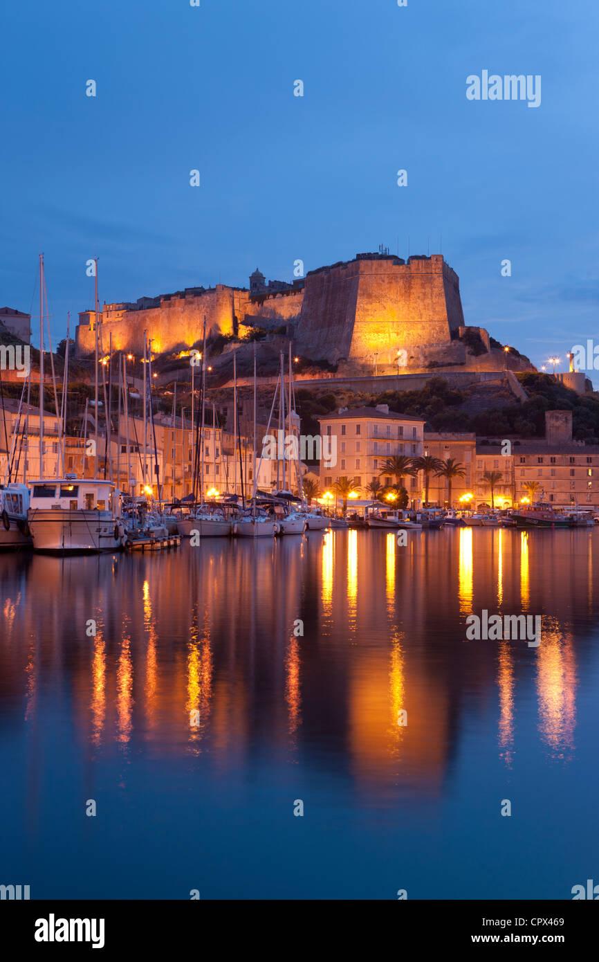 the harbour and Citadel at night, Bonifacio, Corsica, France - Stock Image
