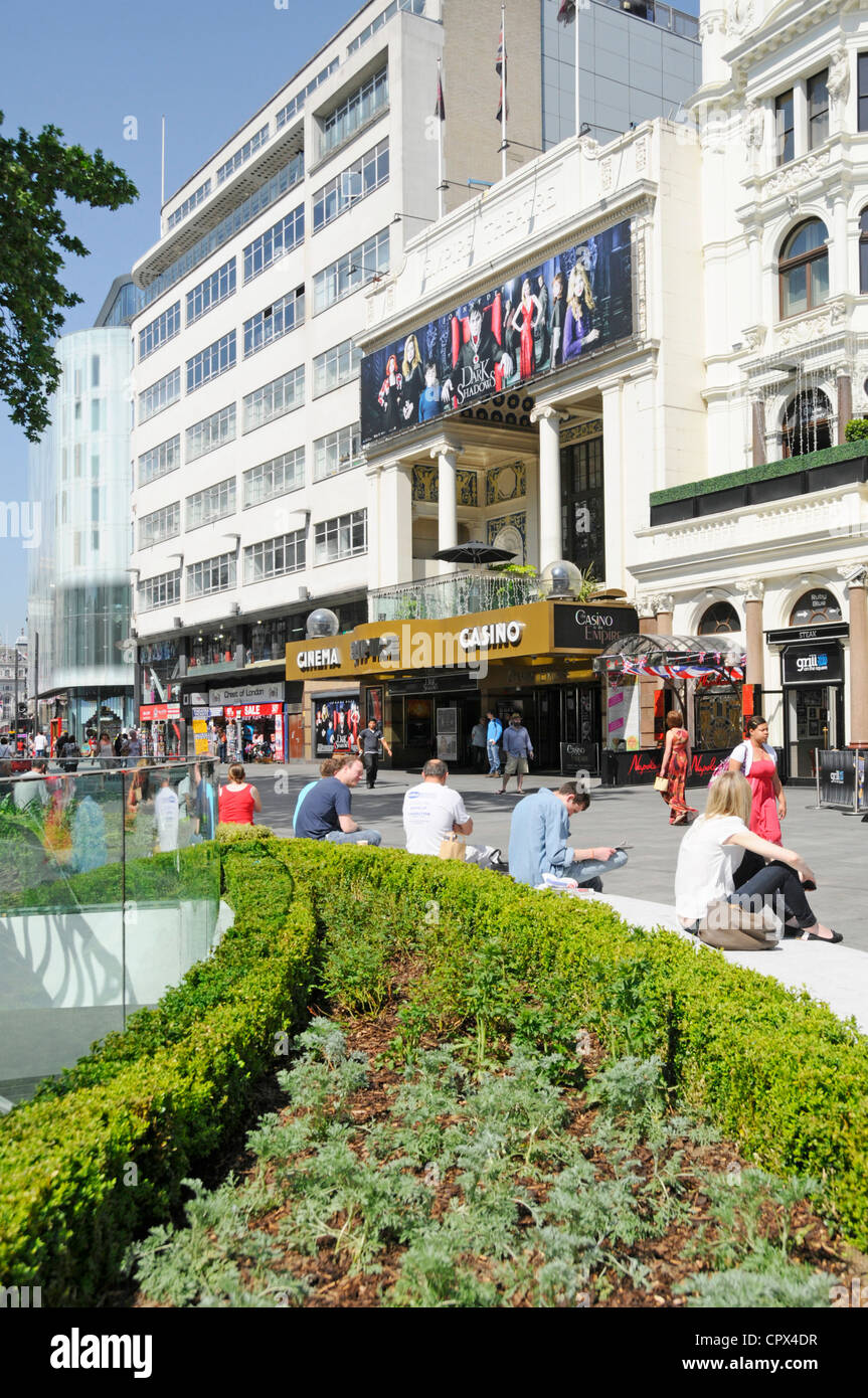 Leicester Square refurbished street amenities with Empire cinema and casino beyond - Stock Image