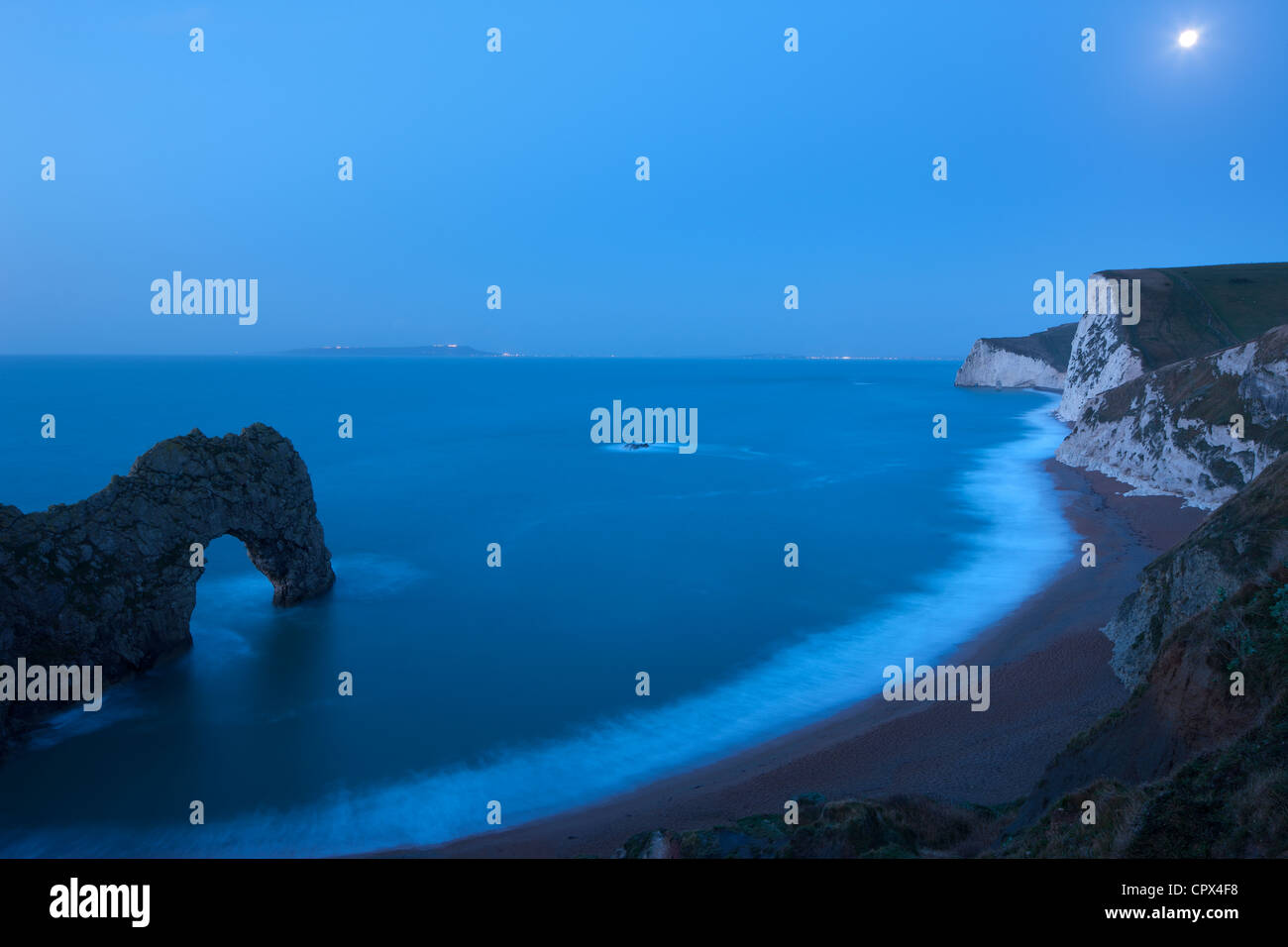 moonlight on the Jurassic Coast, with Durdle Door (left) and Portland beyond, Dorset, England, UK - Stock Image